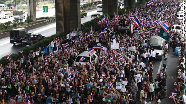 "Flag-waving protesters vowing to topple the Thai prime minister took to the streets of Bangkok for a fourth day Wednesday, declaring they would take over ""every ministry"" of the government."