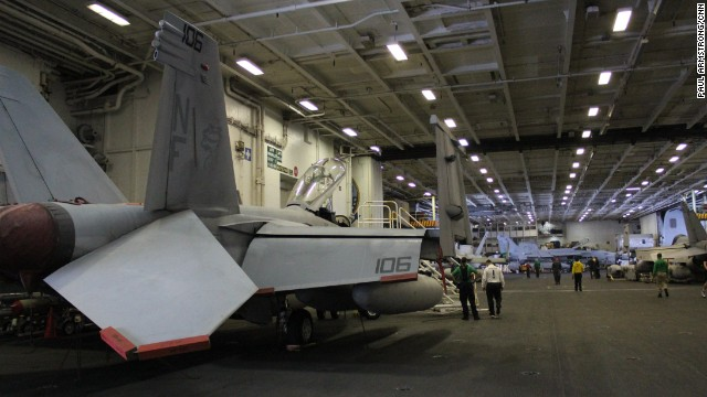 Below the flight deck, vital maintenance is carried out on aircraft in the carrier's giant hangers -- assets are lowered from the top deck on giant lifts.