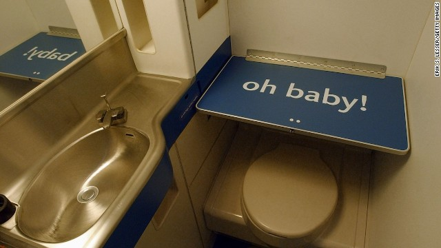 Airplane changing tables are there for a reason -- to ensure you don't have to take care of baby's business at your seat.