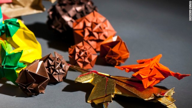 "Every origami model relies on a blueprint - a series of pre-determined creases that guide the folder through the process. Yongquan LuI, a mathematics major and incoming president of OrigaMIT says: ""I really love how systematic it is. It's the perfect combination of math and art."""