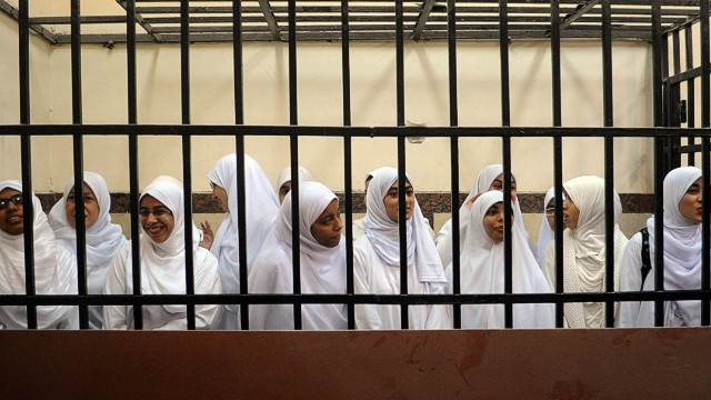 Female members of the Muslim Brotherhood are seen during their trial in the Egyptian city of Alexandria on November 27, 2013.