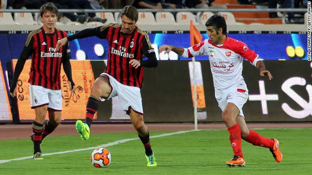 The star-studded Milan side included legendary defender Paolo Maldini, pictured center with teammate Stefano Eranio and Persepolis' Pejman Jamshidi (right). Maldini spent his entire career at Milan before retiring at the age of 41 in 2009.