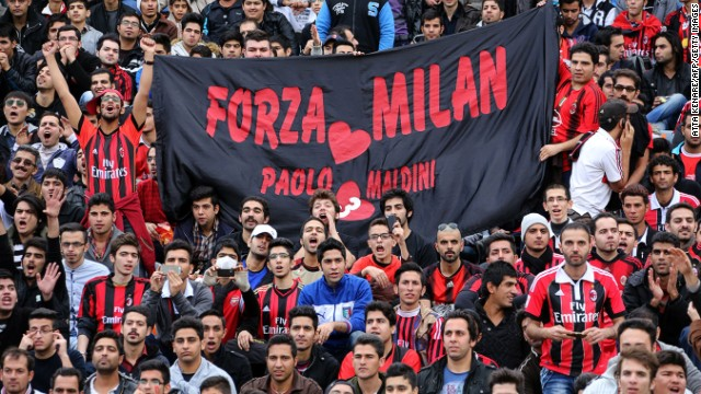 Iranian supporters of AC Milan welcome former players of the Italian soccer club for a charity match at Tehran's Azadi stadium.
