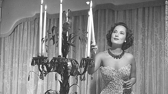Hollywood actress Merle Oberon, pictured here at her home in the 1950s, commissioned a valuable Cartier necklace that she is wearing in the picture, in 1938.
