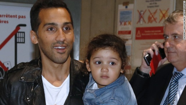 The 34-year-old, here holding one of his two young daughters, had not been able to leave Qatar after he filed a complaint against his club Al-Jaish over a payment dispute.