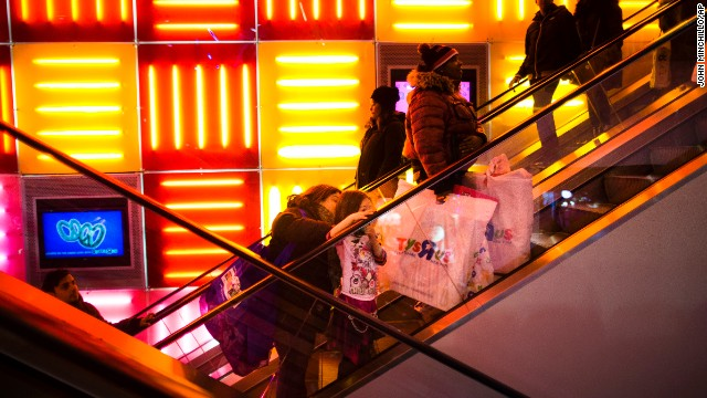 Shoppers ride the escalators at the Times Square Toys R Us on Thanksgiving Day.