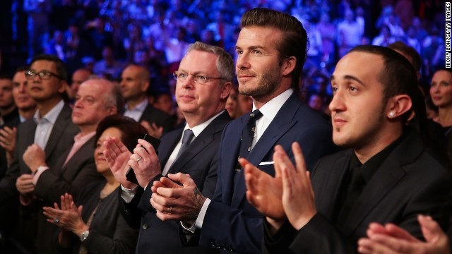 "You can't deny he looks good in a suit. David Beckham -- future hotelier -- watches Manny Pacquiao fight Brandon Rios during the ""Clash in Cotai"" at the Venetian Macao on November 24."