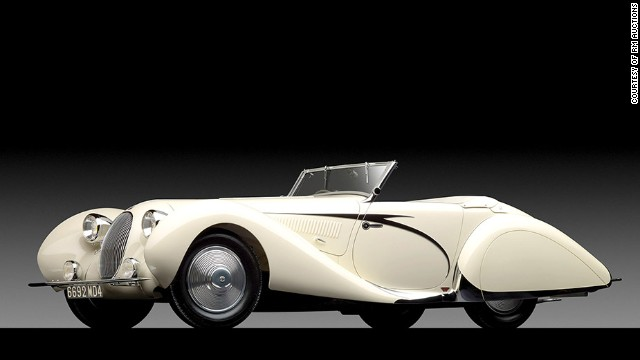 "This 1938 Talbot-Lago T150-C SS, with its body by the firm of Figoni et Falaschi, is considered a masterpiece of French Art Deco design. It sold for nearly $7.2 million at the aptly-named ""Art of the Automobile"" auction."