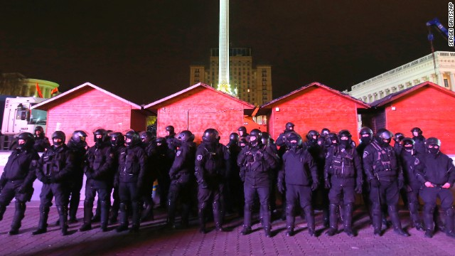 Police officers guard Independence Square on November 30 after dispersing a rally.