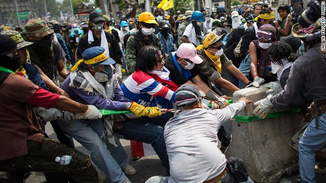 Protesters remove part of a barricade as they attempt to occupy the Government House on Sunday, December 1.