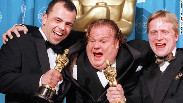 "Chris Farley, at center with filmmakers Tyron Montgomery, left, and Thomas Stellmach after they won the Oscar for best animated short film for ""Quest"" in 1997. Farley reportedly was working on the animated film ""Shrek"" when he died of an overdose in 1997. His ""SNL"" colleague Mike Myers would go on to snag the role."