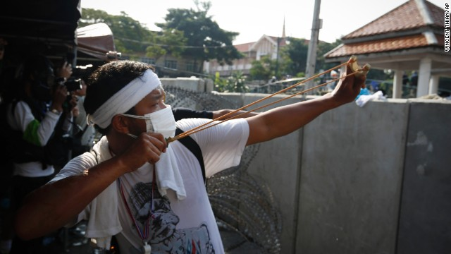 A protester aims a slingshot at riot police December 2 in Bangkok.