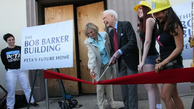 "Barker and Ingrid Newkirk, president of People for the Ethical Treatment of Animals, cut the ribbon at the dedication ceremony of PETA's Los Angeles office in 2010. The office was named ""The Bob Barker Building."" Barker donated $2.5 million to PETA to purchase and renovate it."