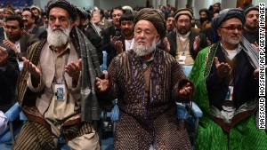 Members of the Afghan loya jirga, a meeting of around 2,500 tribal elders, pray on the last day of the four-day meeting.\n