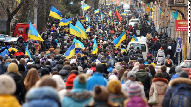 Thousands of demonstrators march in the western Ukrainian city of Lviv on Monday.