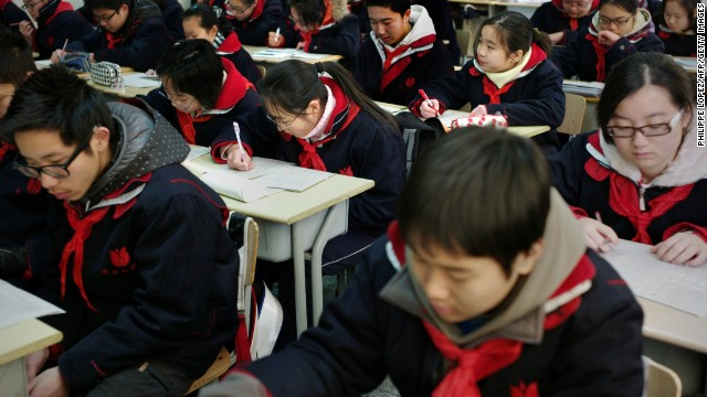 Students attend class at the Jing'an Education College Affiliated School in Shanghai. The Chinese city of 23 million people topped PISA's 2012 study, performing at a level at least one year more advanced than the average 15-year-old in math, science and reading.