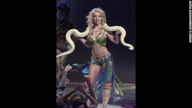 Spears famously performs with a snake draped over her shoulders at the 2001 MTV Video Music Awards in New York City.
