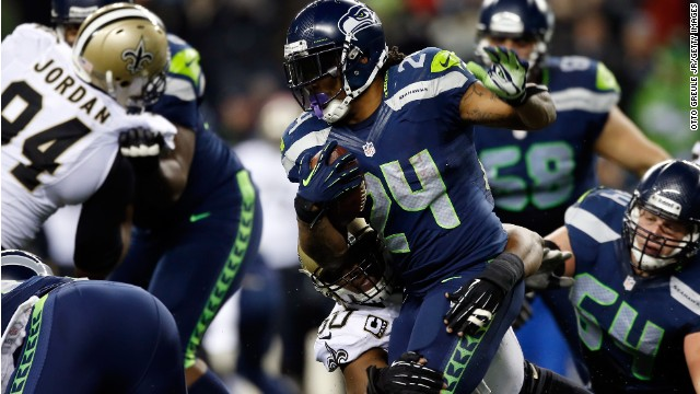 Running back Marshawn Lynch of the Seattle Seahawks carries the ball against the New Orleans Saints.