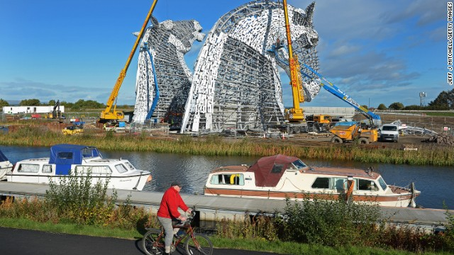 The Kelpies are a tribute to Scotland's industrial past and the working horses that used to pull barges along its canals and also work in the fields where they now stand.