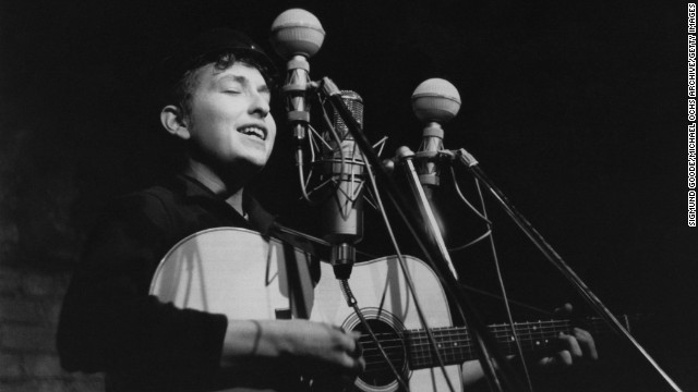 "Dylan performs in 1961 at The Bitter End club in New York City. His first album, ""Bob Dylan,"" debuted in 1962 and consisted mostly of old folk songs."