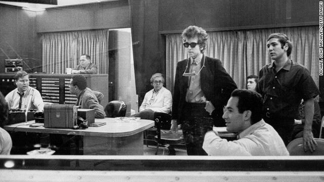 "Dylan listens to recordings of his album ""Highway 61 Revisited"" in 1965. It contained ""Like a Rolling Stone,"" which went to No. 2 on U.S. charts."