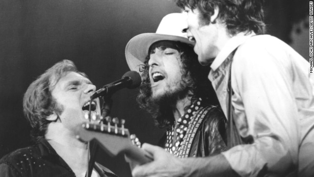 Dylan performs with Robbie Robertson of The Band, right, and Van Morrison at The Band's farewell concert in 1976.