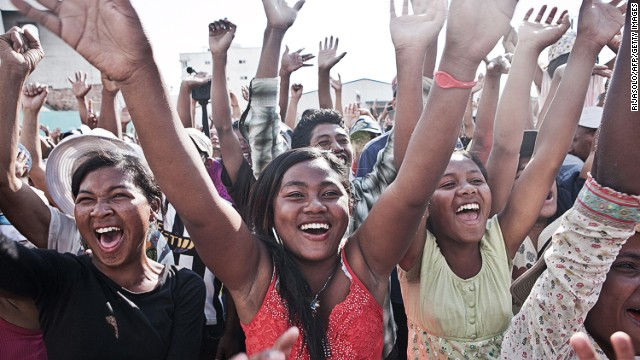 Supporters cheer presidential candidate Robinson Jean-Louis as he takes part in a rally in downtown Antananarivo, Madagascar, on October 26, 2013, a day after the first round of the presidential election.