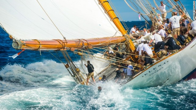 Some pictures highlight the treacherous nature of the seas -- not that the yachtsman in question here looks unduly concerned as he appears to dip into the water on-board the sailboat Elena.