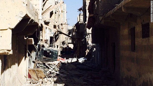 Most of the town was reduced to rubble as a Syrian army siege reclaimed the rebel-held suburb in early November.