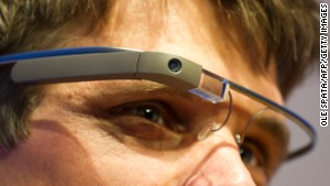 Google\'s connected Glass headset contains a camera and tiny screen above the wearer\'s right eye.