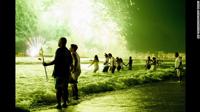 <strong>January 1:</strong> People watch New Year's fireworks along Copacabana Beach in Rio de Janeiro. Photographers worldwide captured deadly conflicts, devastating storms and other memorable moments throughout the year. Click through the gallery to see 2013 unfold from beginning to end.