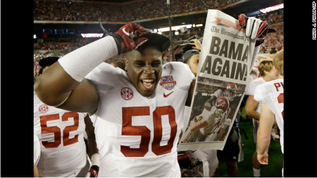 <strong>January 7:</strong> Alabama defensive lineman Alphonse Taylor holds up a newspaper after Alabama defeated Notre Dame 42-14 in the BCS National Championship game. It was the second straight national title for the Crimson Tide.