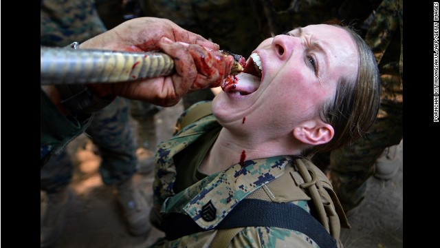 <strong>February 20:</strong> A U.S. Marine drinks cobra blood during a jungle survival program at a base in Sattahip, Thailand.