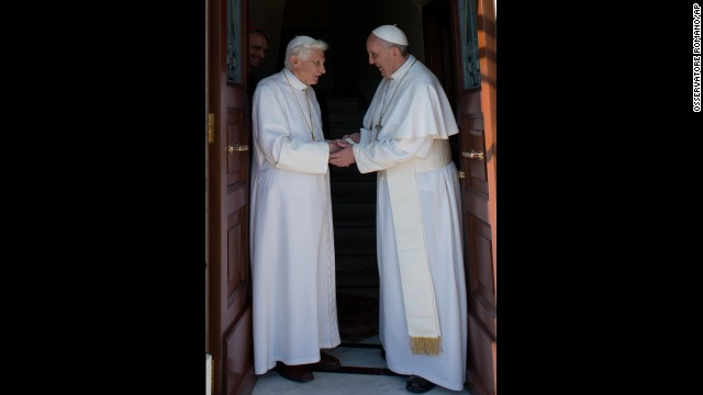 <strong>May 2:</strong> Pope Emeritus Benedict XVI, left, is welcomed by his successor, Pope Francis, as he returns to the Vatican. The former pope retired in February.