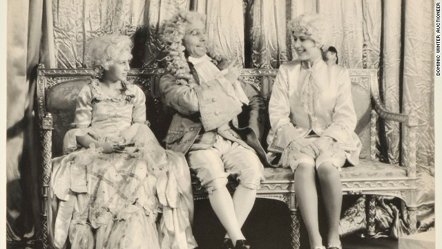 Princess Margaret (L) and Princess Elizabeth (R) on stage in a pantomime of Cinderella at Windsor Castle in 1941. Photos of the sisters in four plays during World War II are up for auction.
