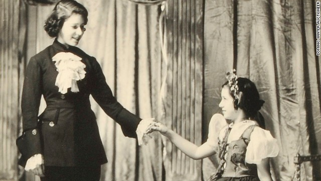 Princesses Elizabeth (L) and Margaret on stage.