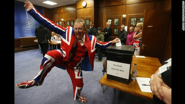 <strong>March 10:</strong> A man wearing a Union flag suit dances as he casts his vote on whether the Falkland Islands should remain a British territory. Residents of the islands, which Argentina calls the Malvinas, voted to remain under British rule.