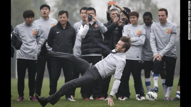 <strong>March 23:</strong> Soccer star David Beckham falls during a visit with Wuhan Zall, a professional team in Wuhan, China.