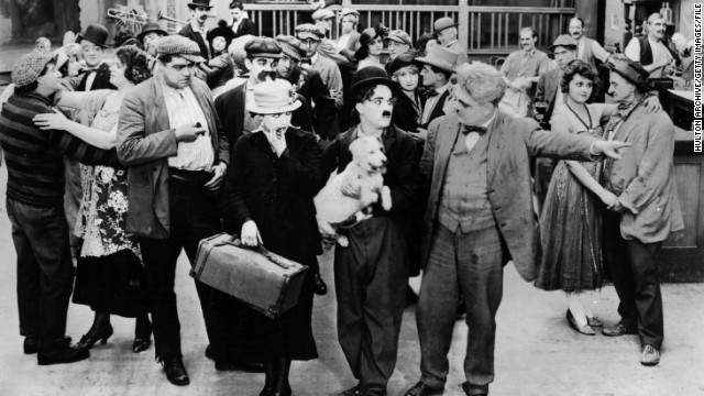 "Here, Chaplin appears as the iconic ""Tramp"" in 1918 film ""A Dog's Life."" From humble beginnings growing up in an impoverished home and orphanages in London, Chaplin became one of the most famous film stars in the world."