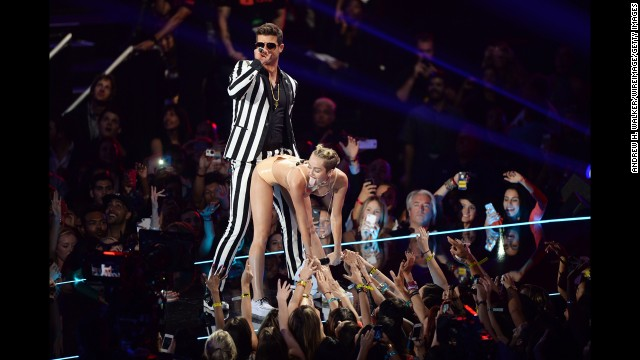 <strong>August 25:</strong> Robin Thicke and Miley Cyrus perform on stage during the MTV Video Music Awards in New York. The provocative performance dominated the headlines and had many people discussing whether it was too risque.