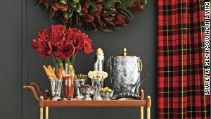 This bar cart gets a holiday treatment with silver bowls and an arrangement of amarillis, but could easily transition to everyday decor.