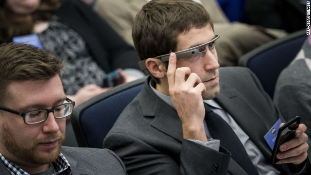 Here, an attendee uses Google Glass during the White House Youth Summit at the White House. U.S. President Barack Obama was speaking to the group about healthcare.