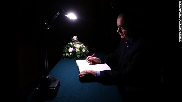 <strong>December 3:</strong> Scottish First Minister Alex Salmond signs a book of condolence at Glasgow City Chambers for those who died when a police helicopter crashed into a busy pub in Glasgow, Scotland. At least nine people were killed and 14 were seriously injured.