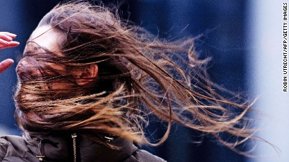 A woman struggles against the wind in Rotterdam, Netherlands, on Thursday, December 5.