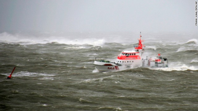 A rescue vessel patrols the rough waters around the North Sea island of Norderney, Germany, on December 5.