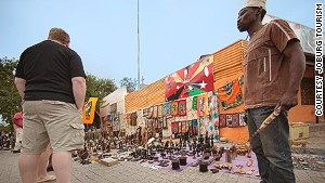 Vilakazi Street -- where successful locals rev up their Mercs and play South African house music.