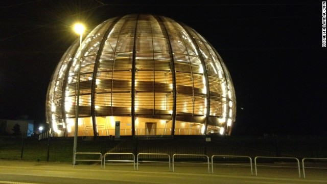 The Large Hadron Collider is located at CERN, the European Organization for Nuclear Research, near Geneva, Switzerland. This is CERN's Globe of Science and Innovation, which hosts a small museum about particle physics inside. The ATLAS experiment, which also detected the Higgs boson, is housed underground nearby.