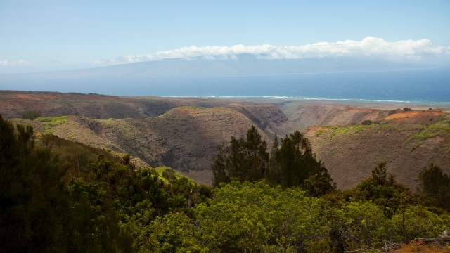 On the island of Lanai, you can see the valley view toward the nearby island of Molokai.