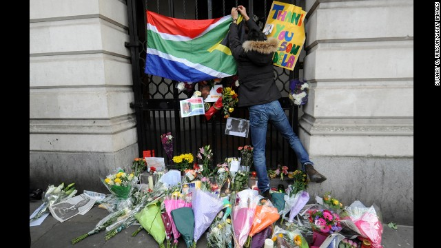 Members of the public lay tributes to Mandela in London outside South Africa House near Trafalgar Square on December 6.