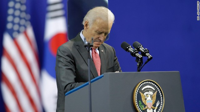 U.S. Vice President Joe Biden pays a silent tribute to Mandela before his speech at Yonsei University in Seoul, South Korea, on December 6.